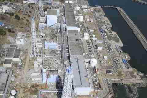 In this March 24, 2011 aerial photo taken by small unmanned drone and released by AIR PHOTO SERVICE, the crippled Fukushima Dai-ichi nuclear power plant is seen in Okumamachi, Fukushima prefecture, northern Japan. From top to bottom, Unit 1 through Unit 4.(Air Photo Service Co. Ltd., Japan)